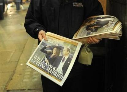 A London Evening Standard distributor hands out copies of the newspaper